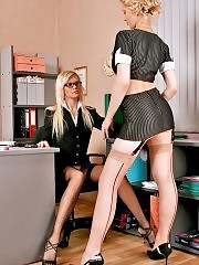 Two horny sluts have lesbian sex in office