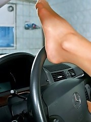 Horny redhead Elisabeth in fashion pantyhose posing inside the car