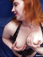 Full red-haired sweetie playing with her melons