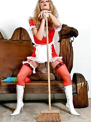 Blonde maid Sielle posing with broom in nice red and white maid outfit