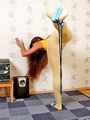 Maria in yellow pantyhose working out with stretching expander