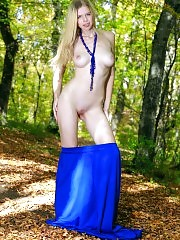 Golden shower of her hair is in well contrast with the deep sea colored dress. The need of creation shown in art manner.
