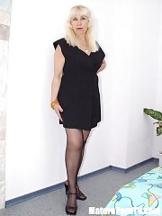 Sexy blonde mature in black stockings undressing and posing