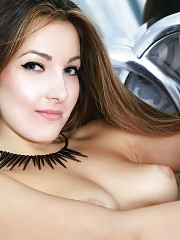 This sexy petite babe slowly undresses out of her elegant clothes so she can get naked to pose with her pussy.