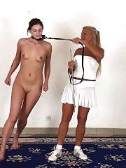 Lesdom training of a collared and leashed bitch