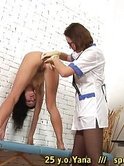 Speculumed bushy vagina and gagged submissive mouth