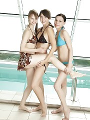 Three lovely teenies playfully stripping off their bikinis and showing off their pussies.