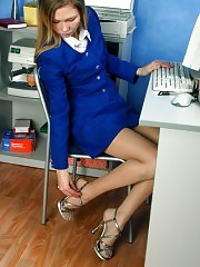 Young secretary playing with her feet in lunch time