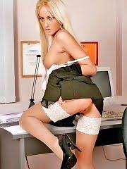 Blonde secretary Julia posing in white stockings