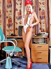 Blonde nurse Camilla spreading her long legs
