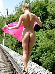 Attractive Busty Angel Is Standing On The Railways Fully Nude And It Is So Hot For Her That She Pour