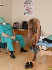 Male doctor checks up a nude blushing chick