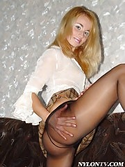 Blonde sex bomb in soft sheer black pantyhose