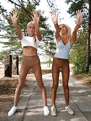 Victoria & Anastasia in pantyhose doing stretching exercises outdoors