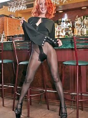Redhead Liz undressing and showing black pantyhose at bar
