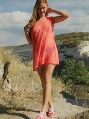 Gorgeous teen embraces the summer with stripping off her clothes in front of beautiful scenery where she can feel free.