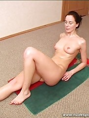 Sweaty girl doing nude stretching exercises