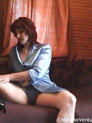Steamy voyeur shots of a dildoing mature chick