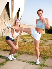 Two sporty babes exercise in tights outdoors