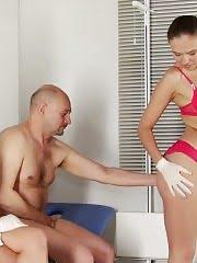 Dressed nurses examine an embarrassed nude dude