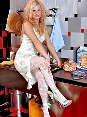 Gorgeous blonde Kristal in white fashion pantyhose posing at kitchen