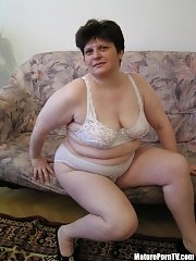Plump mature mom taking off her underwear and posing