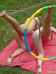 Fresh naked cuties exercising with hula-hoops