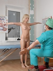 Male doctor examines an obedient blondie