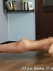 Sensual but active naked exercising on the floor