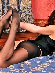 Sexy brunette in exciting crotchless pantyhose