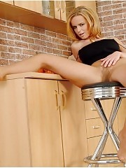 Busty blonde in pantyhose with dildo