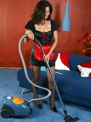 Maid Zemfira operating vacuum cleaner