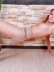 Flexible lovely wench working out in pantyhose