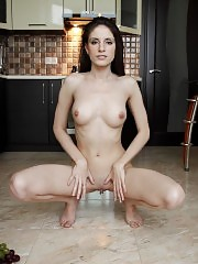 This hot brunette slips out of her clothes in the kitchen, where she shows you a pussy on that you will adore.