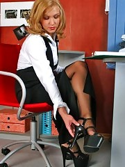 Sexy blonde secretary plays hot high heels game!