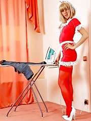 Naughty blonde maid Sessil posing in red stockings during ironing