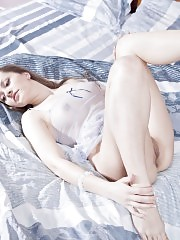 Attractive fresh girlfriend likes the touch of silky underwear. Teasing herself on messed sheets is part of her naughty game.