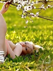 This Time Blonde Girl Poses In Dress On The Grass And Shows Carefully Shaved Pussy In Heat.