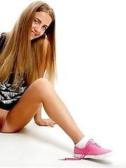 Beautiful Long Haired Teen In Pink Sneakers Stripping And Showing Her Sweet Shaved Pussy.