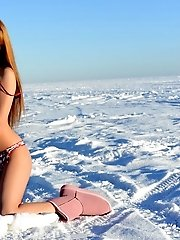 Adorable Long Haired Beauty Stripping And Posing In The Nude Outdoor In The Bitter Cold.